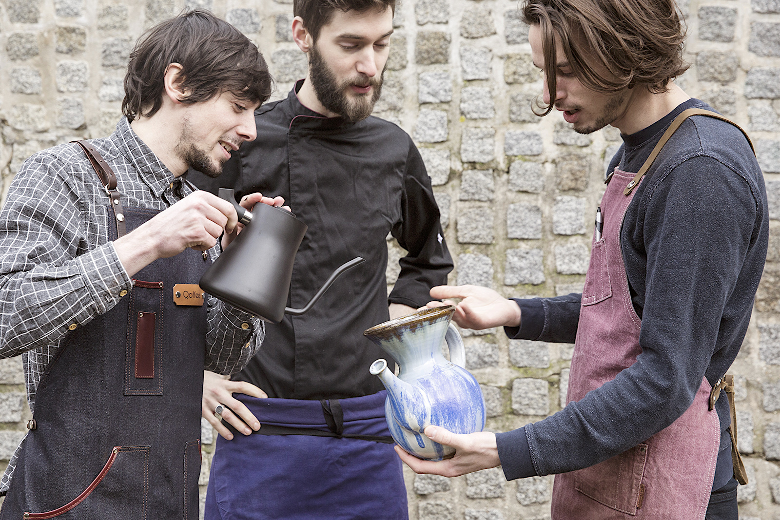 The three founders of La Main Noire organic tea and coffee shop in Paris, making a new concoction.