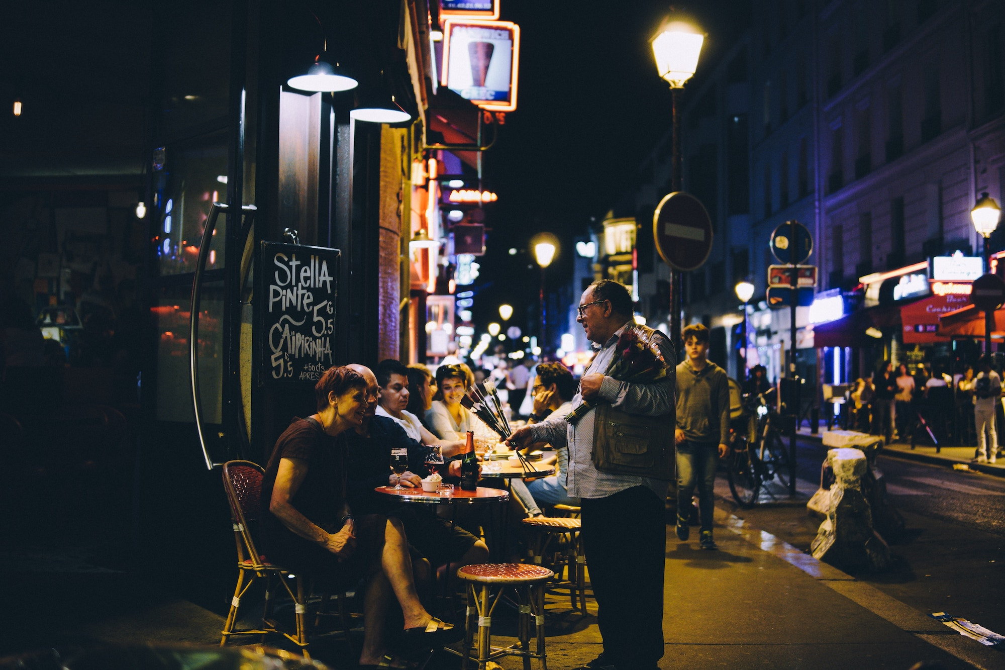 Paris podcast host Oliver Gee tells us how to see Paris on summer nights, and that includes cocktails on a café terrace.