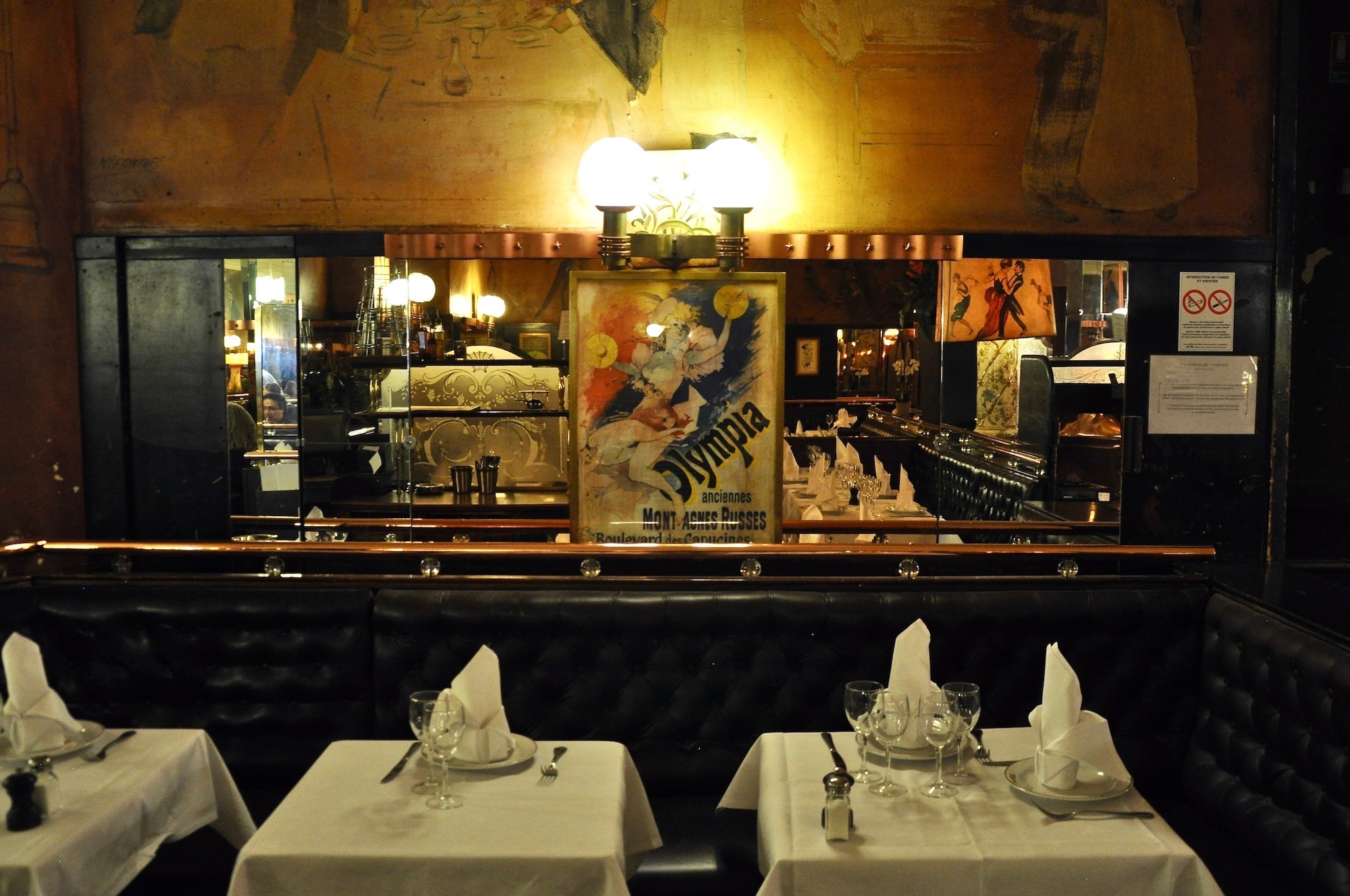 An authentic French brasserie in Paris, Terminus Nord has white clothed tables and art hanging on the walls.