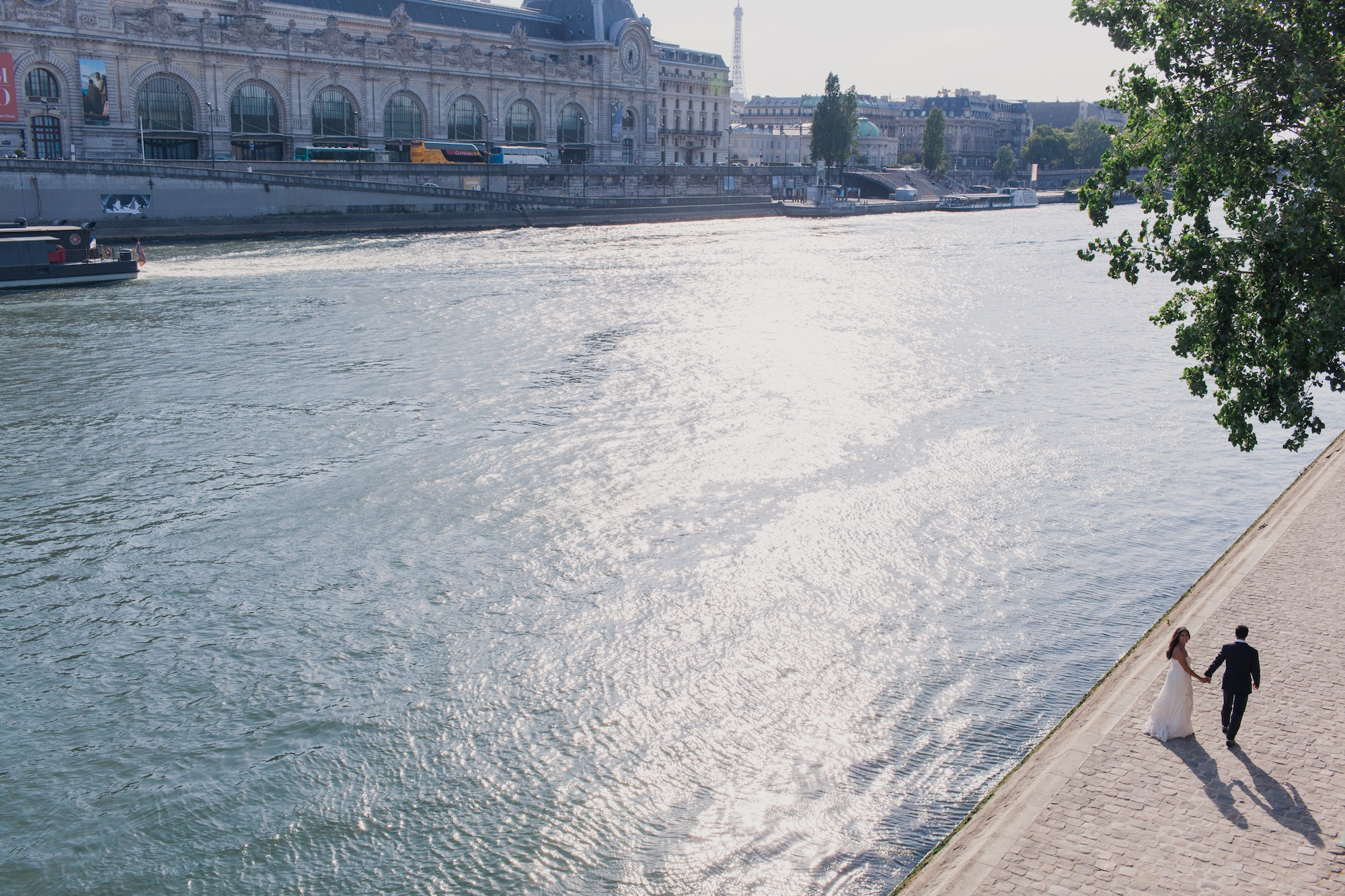 What is it like to live in Paris beyond Instagram? The River Seine and a newly married couple strolling along its banks.