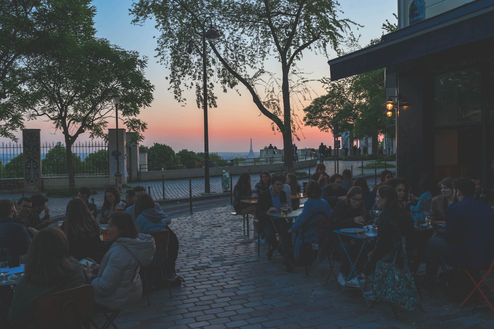 Living in Paris is best in summer when everyone's out on café terraces drinking wine with sunset views of the Eiffel Tower.