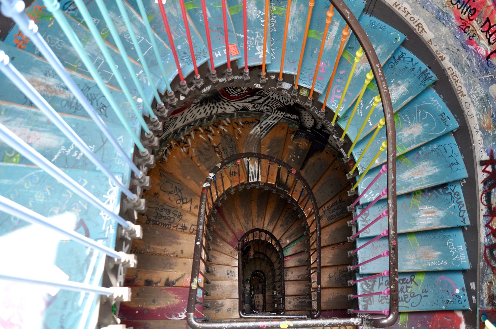 The graffiti covered spiral wooden staircase at artist squat 59 Rivoli in Paris.