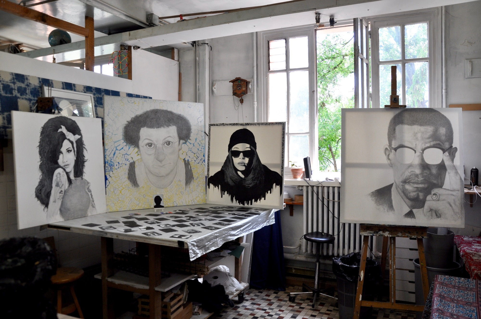 HiP Paris Blog discovers the many artist squats in Paris like the Shakirail with its many artists like those who painted these portraits standing in a studio.
