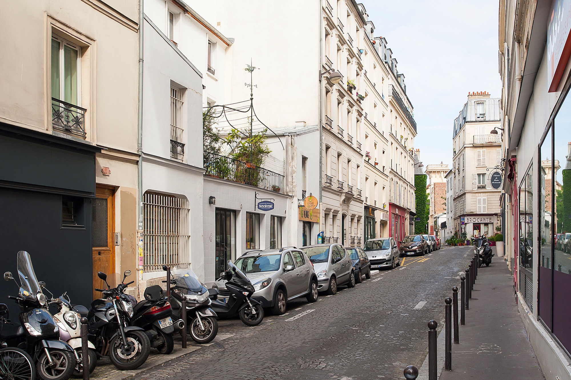The cobblestone street of Montmartre where you'll find artisanal cobbler Atelier Constance.